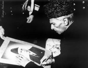 The founder of Pakistan, Muhammad Ali Jinnah, signing an autograph.